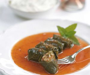 Grape Leaves Stuffed with Rice and Herbs, Cooked in Tomato Sauce